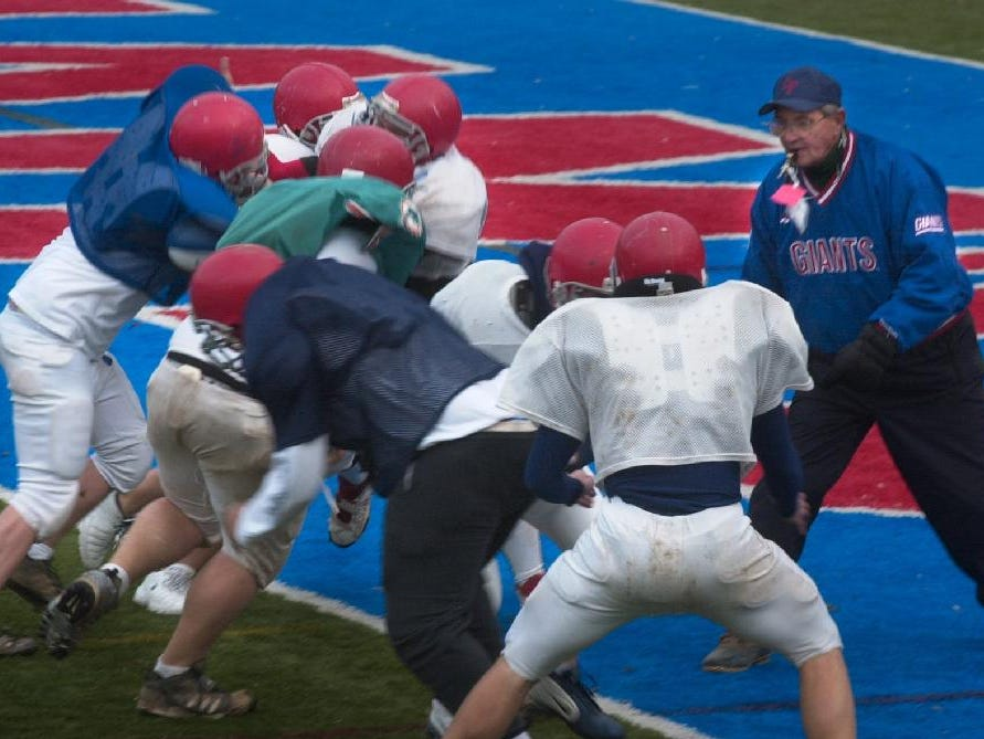 Chenango Forks assistant football coach David Chickanosky watches linemen drill as they readied for Saturday's state championship game on Tuesday.