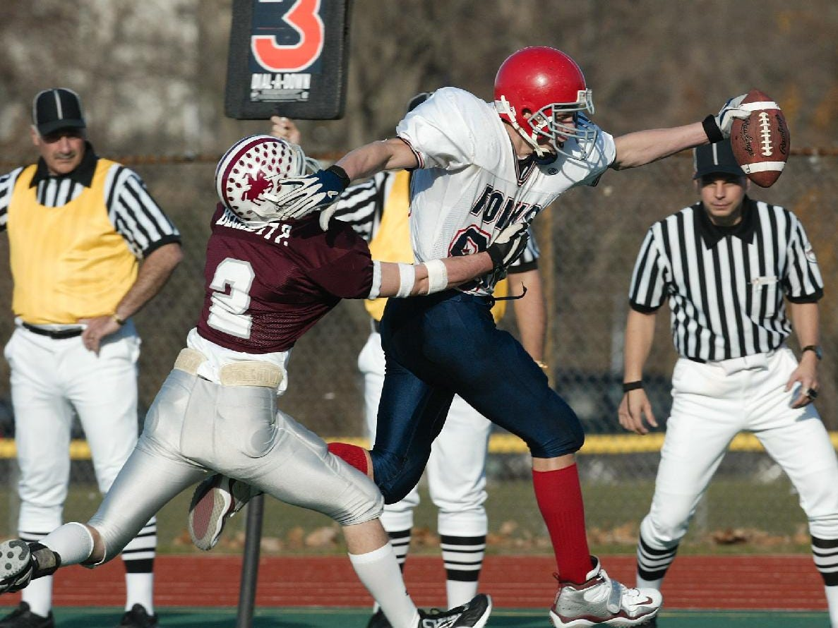 Chenango Forks, #88, Zach Vredenburgh stretches for a first down as Eden, #2, Pat Beckett takes a hold, in the third quarter at University of Rochester, Sunday.