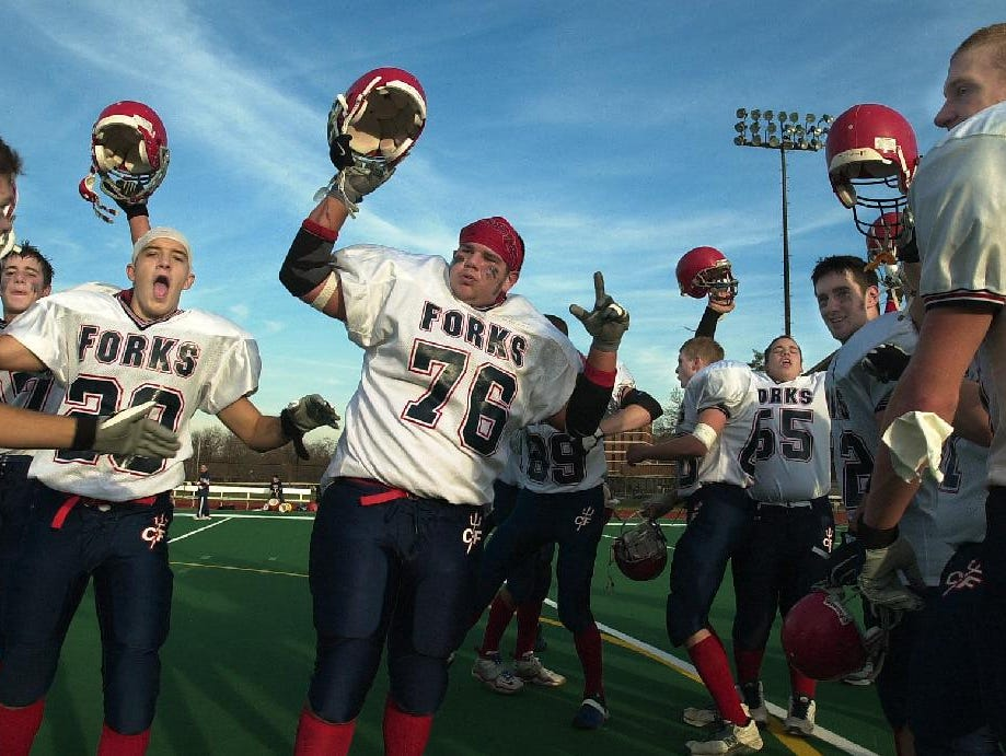 Chenango Forks players celebrate the win at University of Rochester, Sunday.