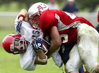 Chenango Forks Jason Chier is plowed over by Chenango Valley John Cirba in the third quarter, Saturday at Chenango Valley High School.