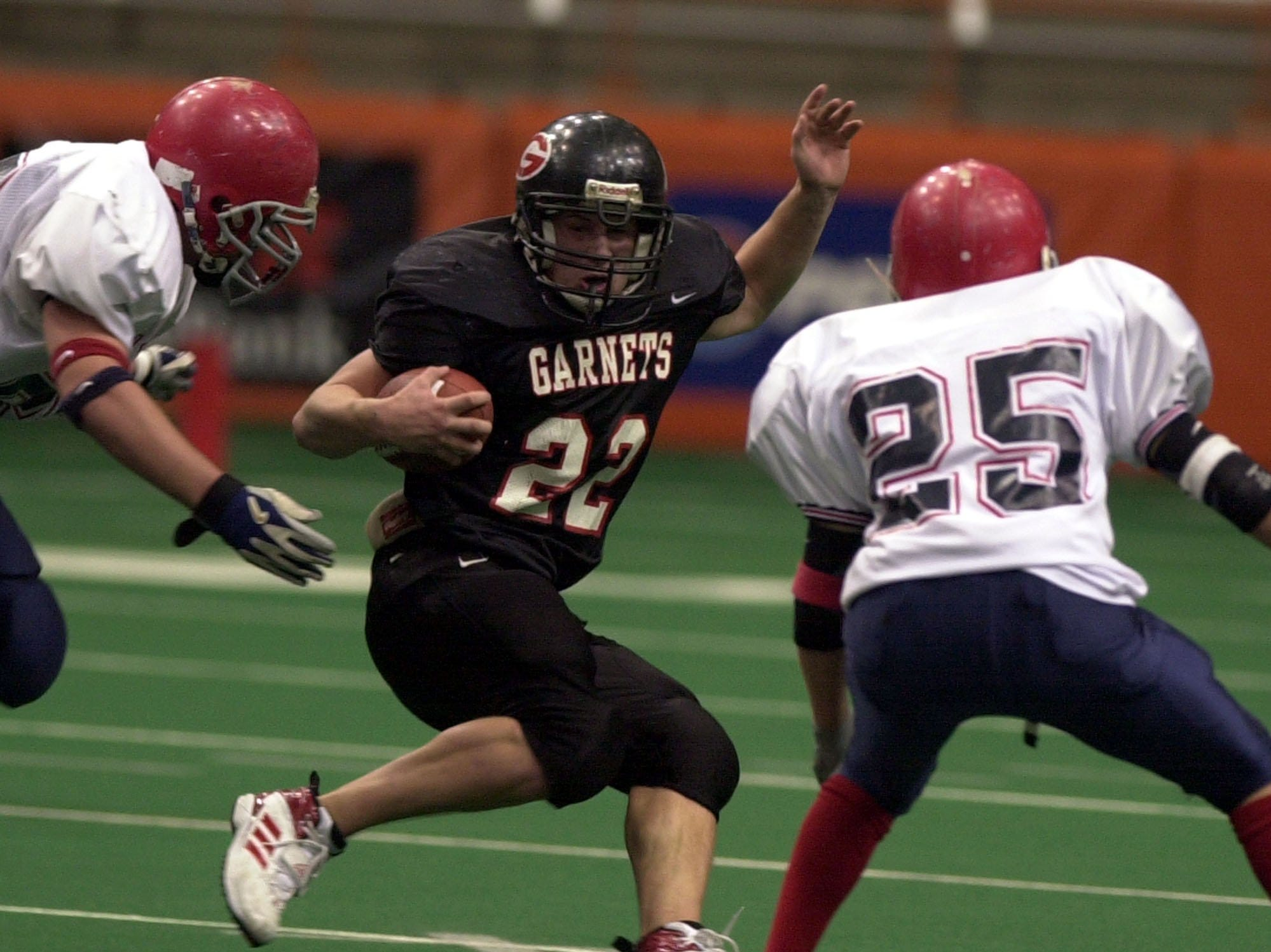 Rye's Eddie Urso maneuvers around Chenango Forks defenders including Jason Chier, right, during the Class B state championship game between Rye High School and Chenango Forks High School, Nov. 29, 2003 at the Carrier Dome in Syracuse, N.Y.