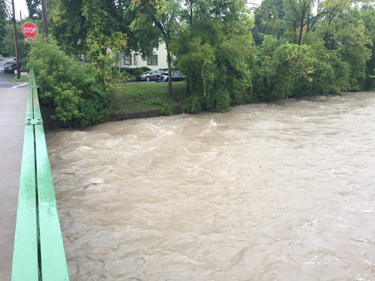 Six Mile Creek on Ithaca's Southside was swollen Tuesday morning following the overnight rain.