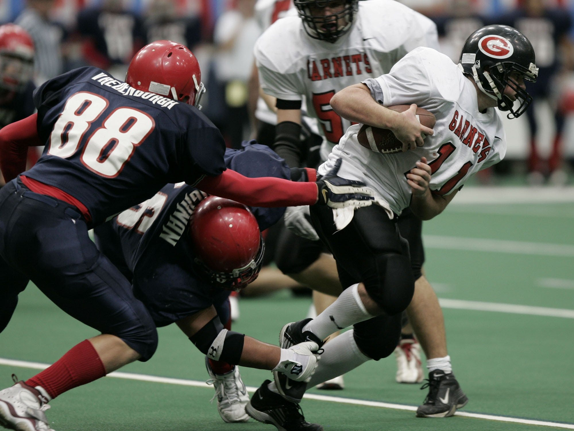 Rye's Jack Donnelly (11) is sacked by Chenango Forks' Matt Faughnan (76) during the Class B State Final at the Carrier Dome in Syracuse, N.Y. Nov. 26, 2004. Chenango Forks won, 48-0.