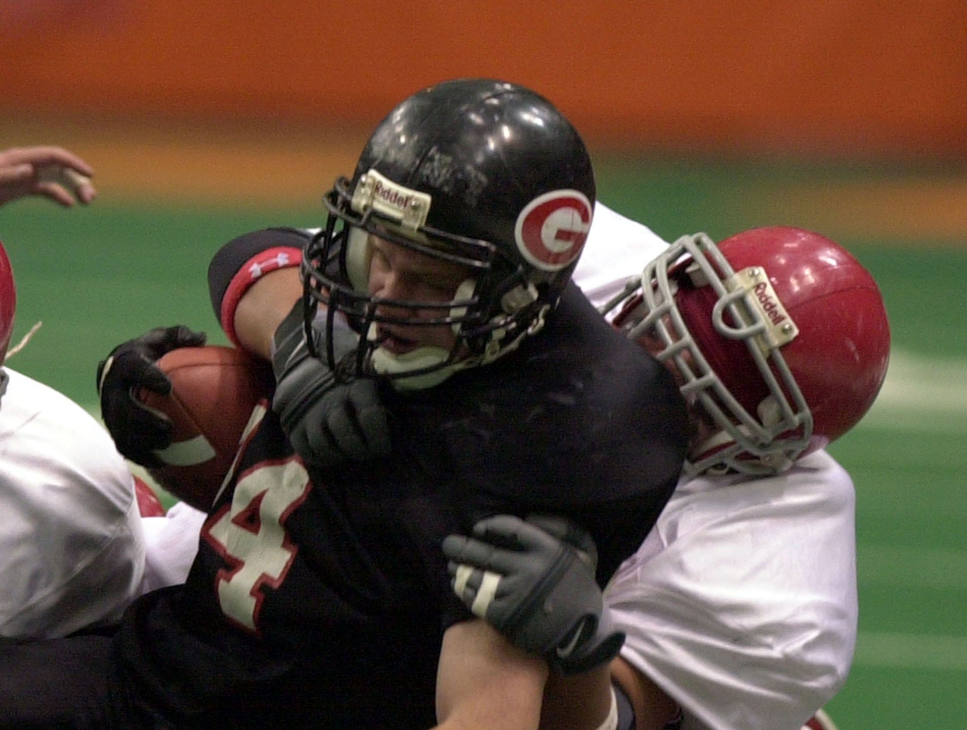Rye's Steve Ramsey is brought down by Chenango Forks Jason Chier during the Class B state championship game between Rye High School and Chenango Forks High School, Nov. 29, 2003 at the Carrier Dome in Syracuse, N.Y.