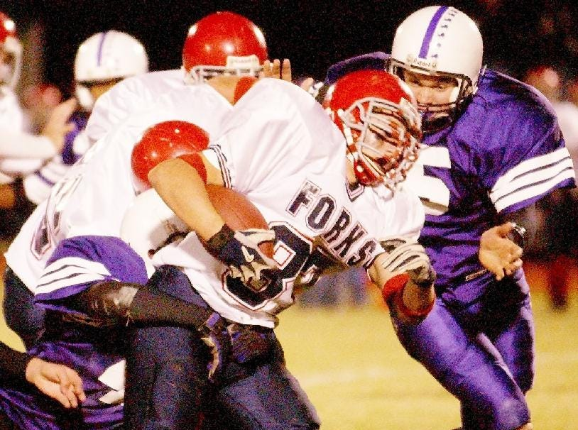 Chenango Forks' Joe Babcock is tackled by Dryden's Mark Stull during the second quarter of Friday night's game in Dryden.