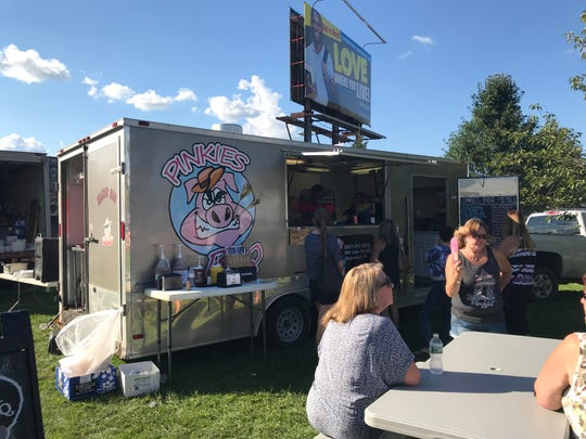 Pinkies Barbecue's food truck serves customers in Downtown Binghamton at Blues on the Bridge on Sept. 16.
