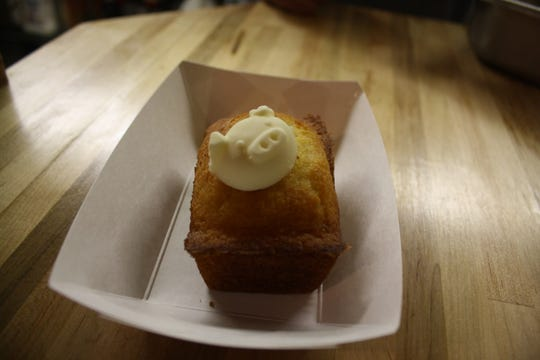 """Pinkies Barbecue is known for its corn bread and signature """"piggy butter,"""" molded in the shape of a pig."""