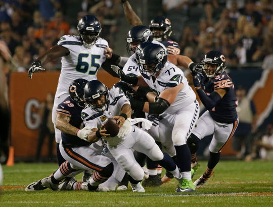 Seahawks quarterback Russell Wilson dives forward during Monday's loss to the Chicago Bears. Wilson was sacked five time in the first half of the 24-17 loss.