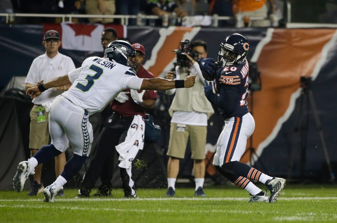Seahawks quarterback Russell Wilson couldn't stop Bears defensive back Prince Amukamara on his way to the end zone during Monday's game in Chicago. Wilson's interception hurt the team's chances of making a comeback in the 24-17 loss.