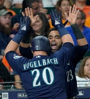 Daniel Vogelbach celebrates with Nelson Cruz  after hitting a grand slam during Monday's win over the Houston Astros. If the Mariners bring Cruz back as their designated  hitter, that could leave Vogelbach with no clear path to playing time in Seattle.