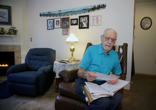 Longtime Silverdale resident Ray Tee served aboard a Navy destroyer during the Battle of Okinawa and went to Nagasaki just weeks after  an atomic bomb ended the war. He keeps a scrapbook of articles of his Navy history.