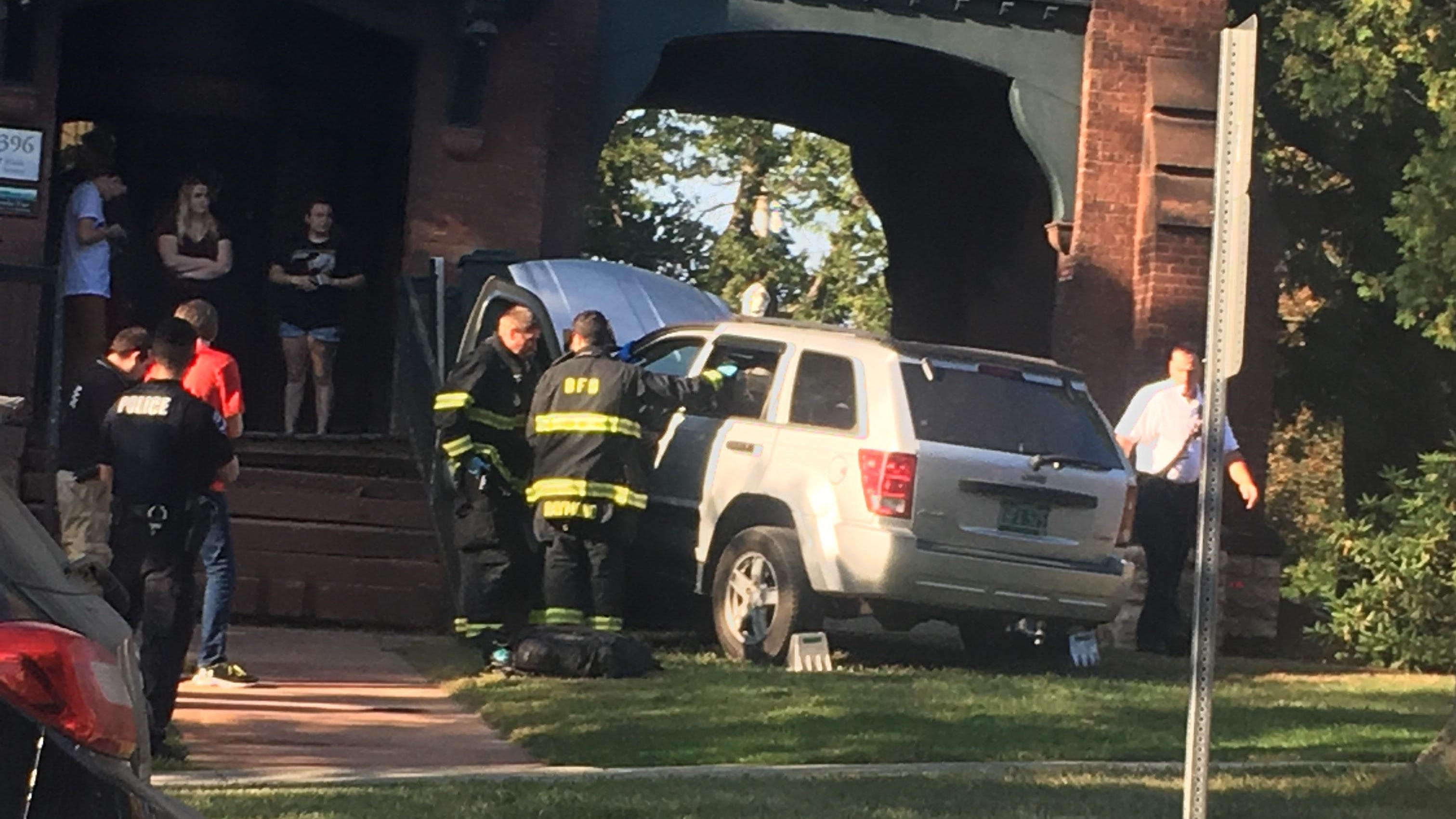 SUV damages Champlain College dorm on Main Street; no serious injuries