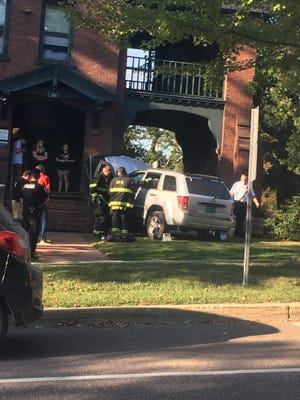 First responders are seen in front of 396 Main St. in Burlington on Tuesday, Sept. 18, 2018, where a vehicle appears to have crashed into a porch. The Champlain College residence hall houses about 34 primarily first year students, according to the college's website.