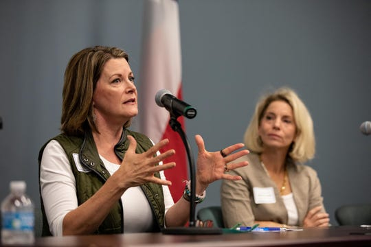 Carol A. Scott, vice char of the Del Mar Board of Regents, answers a question as she takes part in a discussion panel with other educators during a Human Trafficking Summit put on by State Representative Todd Hunter and Del Mar College at the Del Mar Center for Economic Development on Tuesday, Sept. 18, 2018