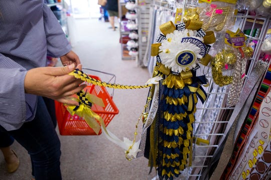 Employees at Superstar Crafts & Homecoming give step-by-step tutorials on how to make homecoming mums on their Facebook page. These are some of the mums employees have made. One popular addition to mums this year are braids.