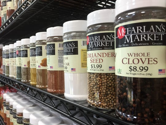 Spices line a shelf at McFarlan's Market in Collingswood.
