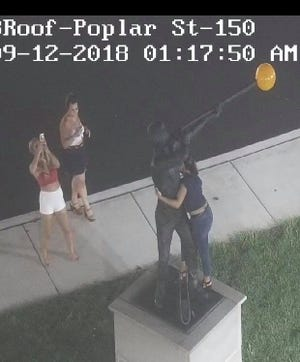 Glassboro police would like to talk to the woman who took advantage of a photo op with the town's new statue.