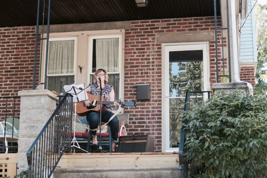 Porchfest organizer Stacey Brown-Downham  is also indie folk musician The Classic Brown, shown here playing solo on her Collingswood porch.