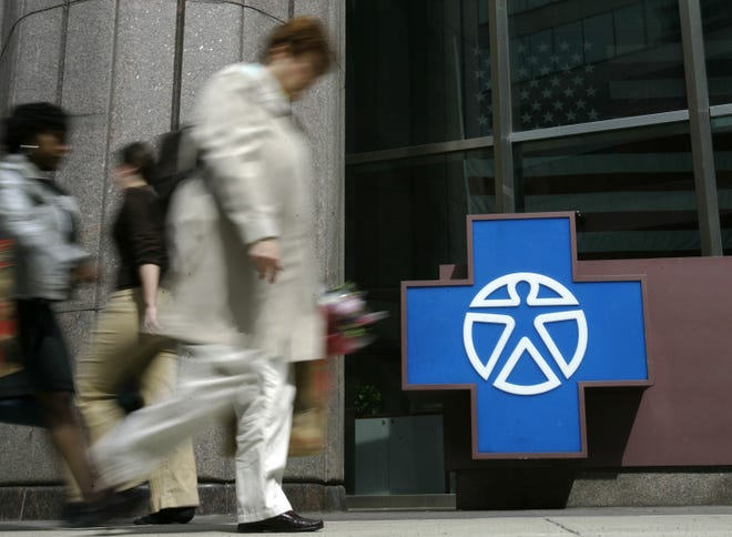 Pedestrians walk past the entrance of Independence Blue Cross headquarters  in Philadelphia. The insurance company notified members this week of a data breach that affected protected information.