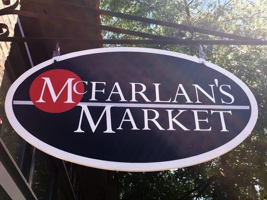 A sign hangs outside McFarlan's Market on Haddon Avenue in Collingswood.