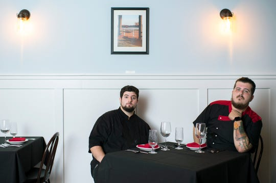Owners Tyler Serenelli, left, and Matt Salvitti take a break from the kitchen in the dining area of C.C. Kitchen, their restaurant in Haddon Heights.