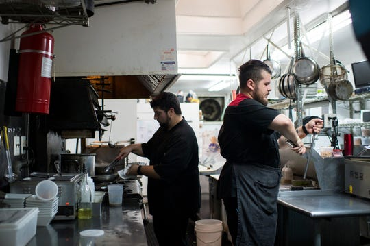Owners Tyler Serenelli, left, and Matt Salvitti work in the kitchen of C.C.'s Kitchen in Haddon Heights. The two also share front-of-house duties.