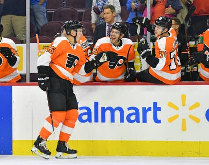 Mikhail Vorobyev (46) celebrates with teammates after scoring a goal during the first period against the New York Islanders.