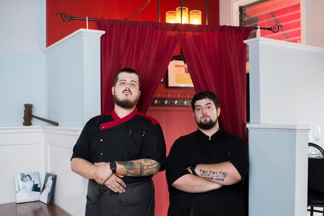 Owners Matt Salvitti, left, and Tyler Serenelli stand inside their restaurant, C.C.'s Kitchen in Haddon Heights. The gavel in the background belonged to Salvitti's grandfather.