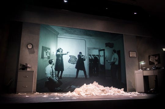 A screen on stage projects a 3-D image during a dress rehearsal of 'NOIR: The 3D/4D SemiCinematic Satirical Thriller' at the Eagle Theatre in Hammonton. The one-man show stars the same actor, playing multiple parts, on stage and onscreen.