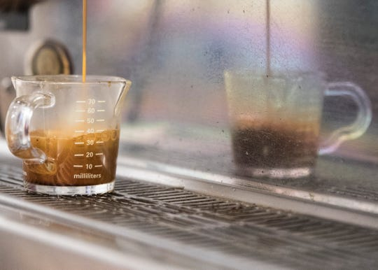 Coffee is brewed in a small measuring cup at rōst coffee before it is added to a finished drink for a customer. The entire  coffee making process from roasting to seeing how the drinks are created is an idea for the new facility.