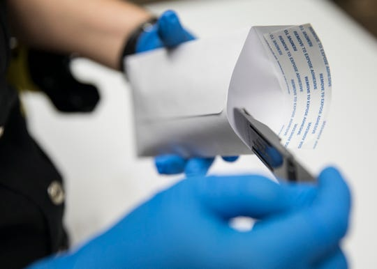 The DNA collection swab is put in a transport pouch and sealed with the information needed to be mailed out to the Ohio Bureau of Criminal Investigation crime lab for testing.