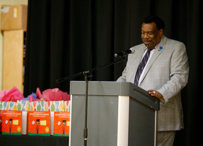 """City councilman Wendell Young delivers a proclamation at Winton Hills Academy in Cincinnati on Tuesday, Sept. 18, 2018. Five students of the academy were named winners, becoming published authors, of a national contest for a book about anti-bullying. The students' book, """"Misunderstanding Micah"""" was selected as the winner of the 2018 National Student Book Scholar Competition by The National Youth Foundation."""