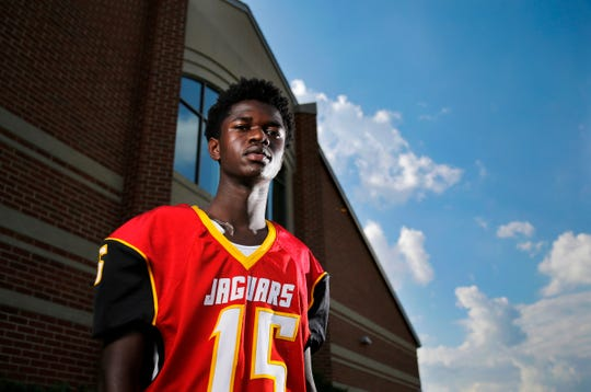 Shroder High School senior Muhammad Bah watches over practice as he poses for a portrait at Shroder High School in Cincinnati on Tuesday, Sept. 18, 2018. The senior kicker will miss the remainder of his senior season after breaking his collarbone on a special teams play.