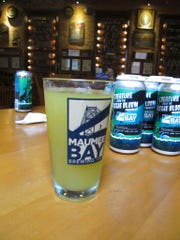 """A glass of """"Alegae Bloom"""" beer at Maumee Bay Brewing Co. in Toledo, Ohio, on Wednesday, Sept. 12, 2018. The brewery is making the green, murky beer to draw attention to the algae blooms that taint Lake Erie's water. (AP Photo/John Seewer)"""