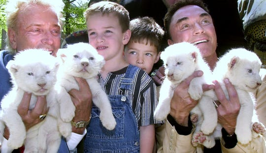 On April 26, 2001, Siegfried Fischbacher (left) and Roy Horn grabbed these two young boys, Justin Nason (left) and Zach Nason, out of the crowd to pose with them.