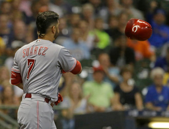 Cincinnati Reds' Eugenio Suarez tosses his helmet after striking out during the third inning of a baseball game against the Milwaukee Brewers Monday, Sept. 17, 2018, in Milwaukee.