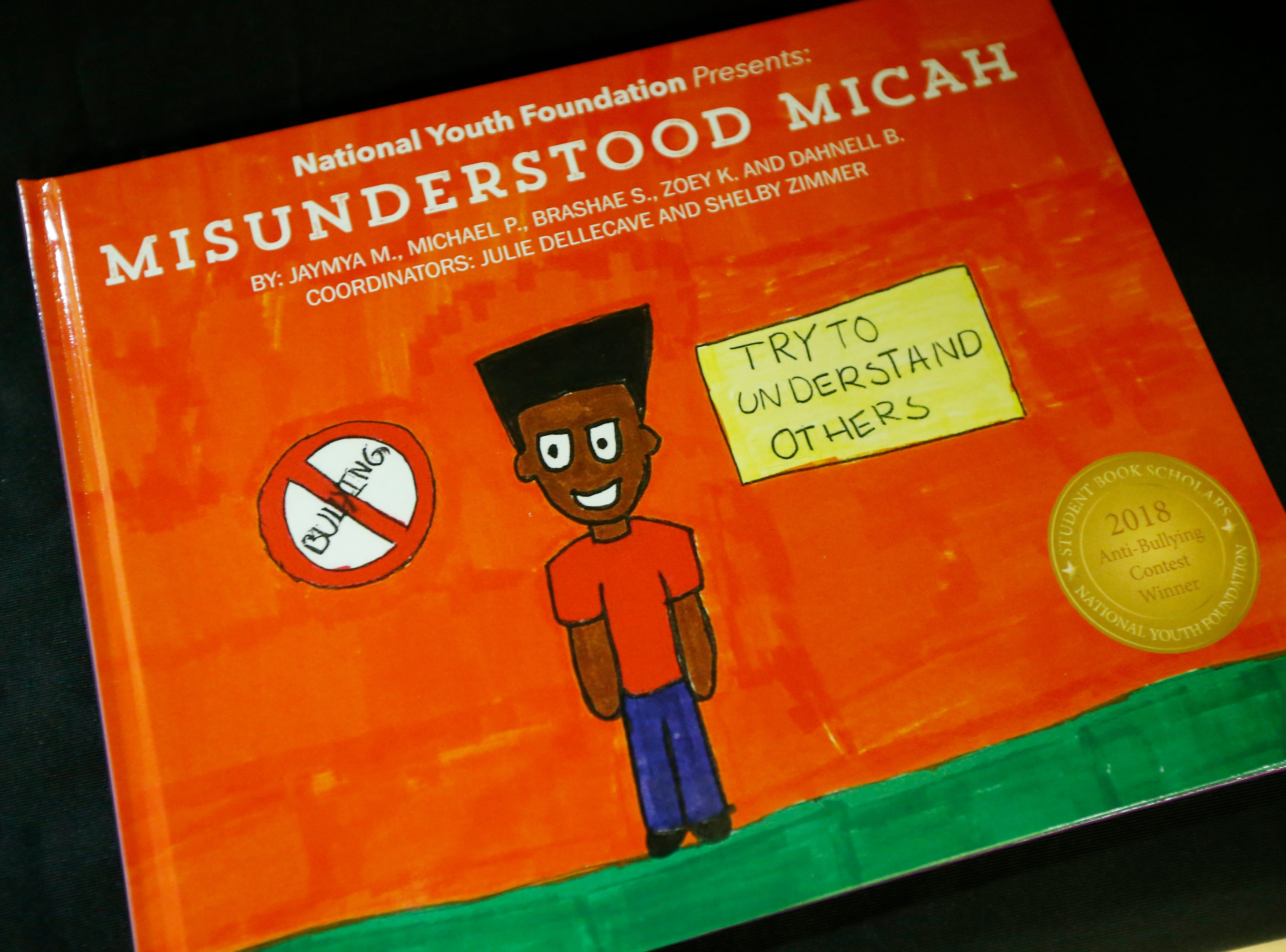"""The cover of """"Misunderstanding Micah"""" written and illustrated by students at Winton Hills Academy in Cincinnati on Tuesday, Sept. 18, 2018. Five students of the academy were named winners, becoming published authors, of a national contest for a book about anti-bullying. The students' book, """"Misunderstanding Micah"""" was selected as the winner of the 2018 National Student Book Scholar Competition by The National Youth Foundation."""