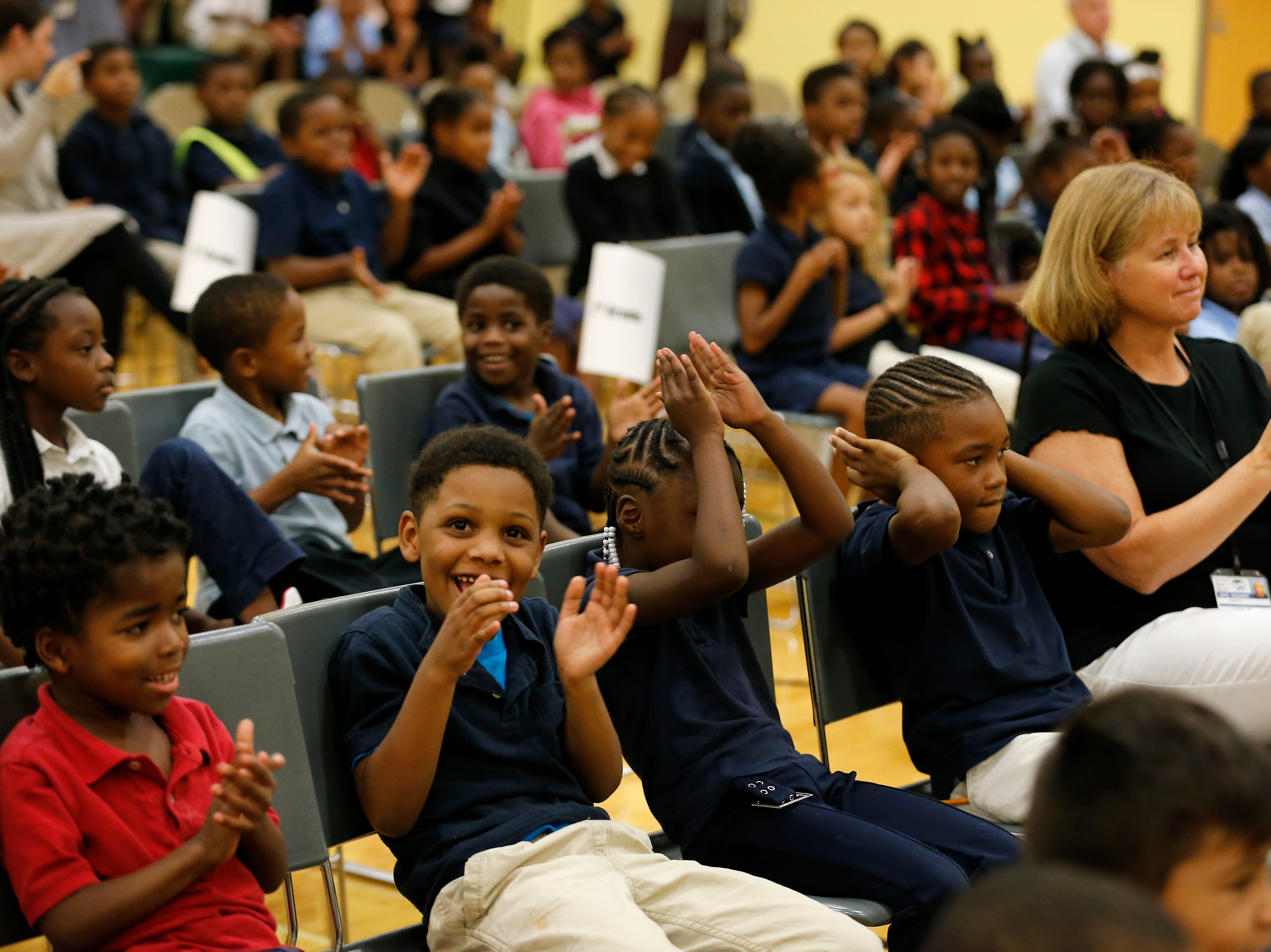 """Students cheer at the beginning of an assembly at Winton Hills Academy in Cincinnati on Tuesday, Sept. 18, 2018. Five students of the academy were named winners, becoming published authors, of a national contest for a book about anti-bullying. The students' book, """"Misunderstanding Micah"""" was selected as the winner of the 2018 National Student Book Scholar Competition by The National Youth Foundation."""