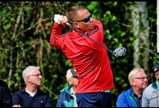 Halligan golfs in Germany