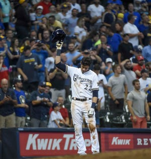 Sep 17, 2018; Milwaukee, WI, USA;  Milwaukee Brewers left fielder Christian Yelich (22) tips his cap to the fans after hitting a triple for the cycle in the sixth inning during the game against the Cincinnati Reds at Miller Park. Mandatory Credit: Benny Sieu-USA TODAY Sports