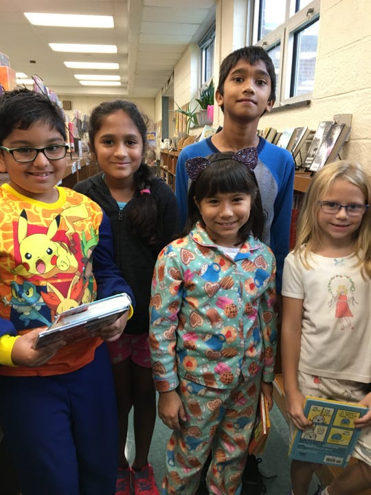 Triangle Elementary School students raises money for Buddy Bench. Left to right: Om Patel, Sahana Patel, Hanna Goldstein, Subbham Sawant and Grace Aull.