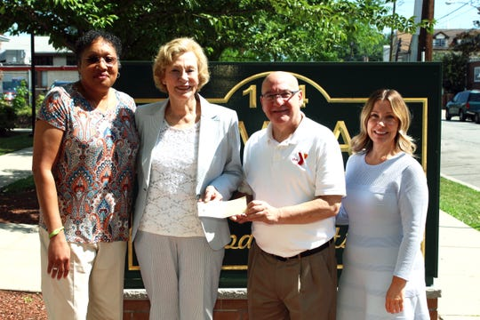 Joanne Rajoppi presents YMCA leaders with a donation to the Annual Support Campaign. (Left to right) Krystal R. Canady, CEO; Joanne Rajoppi, County of Union; James Masterson, Chief Volunteer Officer; and Melynda A. Mileski, EVP/COO, The Gateway Family YMCA.