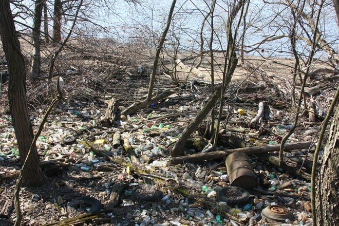 Plastic trash on Petty's Island in the Delaware River is downstream from Lambertville, which recently passed what is considered the most comprehensive single-use plastics ban in the state. Environmentalists say the plastic pollutes the river and harms fish and wildlife.
