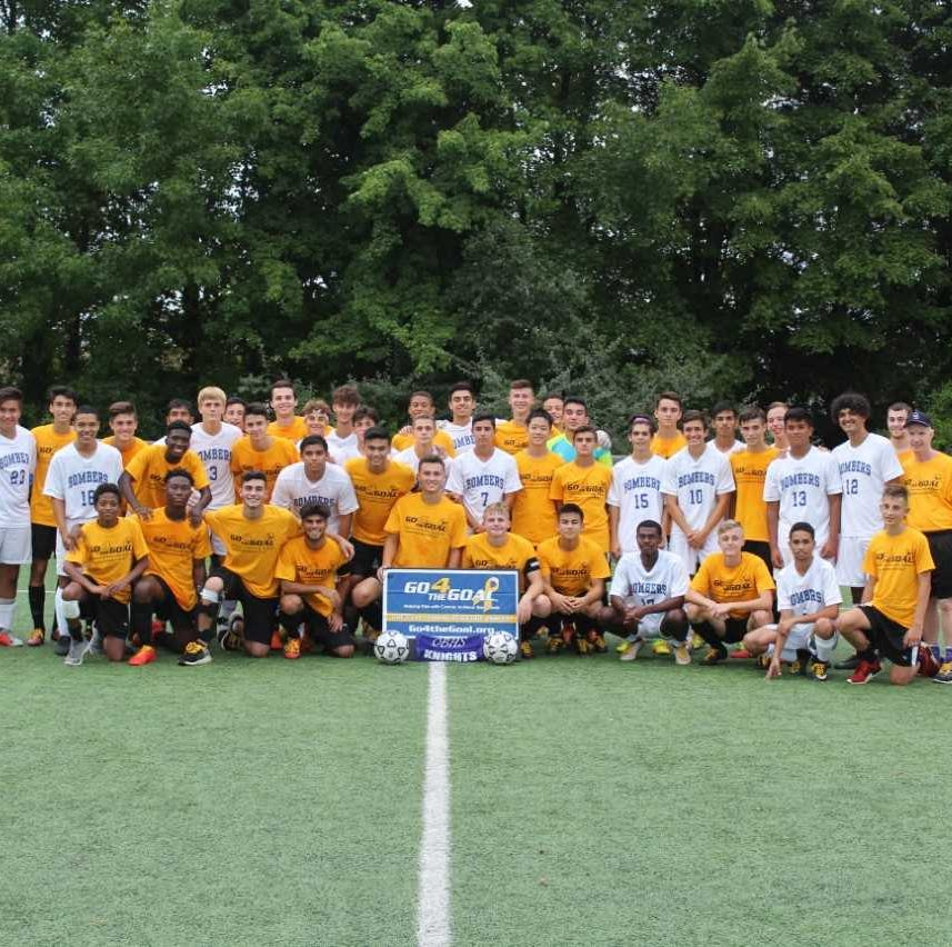 The Old Bridge High School boys soccer team (in gold) and Sayreville played to raise awareness for childhood cancer.