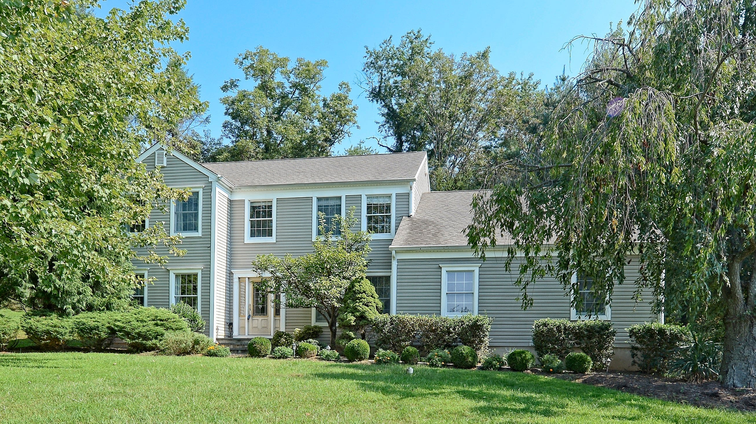 This updated four-bedroom Colonial sits on almost an acre of manicured property with open lawns and mature shade trees.
