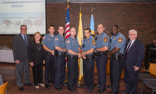 (From left) Middlesex County Freeholder Director Ronald G. Rios; Dorothy K. Power, chairman of the Middlesex County College Board of Trustees; Sergeant Cory Smith; Officer Shawn Ferguson; Captain Michael Ambroziak; Officer Bryan Montalvo, Officer Christopher Halley, Officer Jean-Pierre Mercenat; and Interim President Mark McCormick.