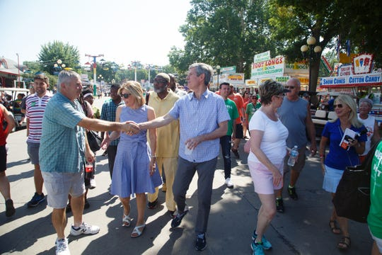 Iowa Democratic candidate for governor Fred Hubbell greets supporters as he makes his way through the Grand Concourse at the Iowa State Fair on Thursday, Aug. 9, 2018 in Des Moines.