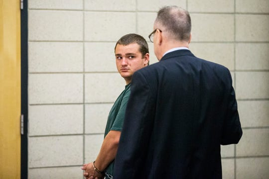 Collin Daniel Richards looks over his shoulder toward his lawyer, as he leaves the courtroom following his initial court appearance after being charged with first-degree murder in the death of Iowa State golfer Celia Barquin Arozamena, on Tuesday, Sept. 18, 2018, at the Story County Courthouse in Nevada.