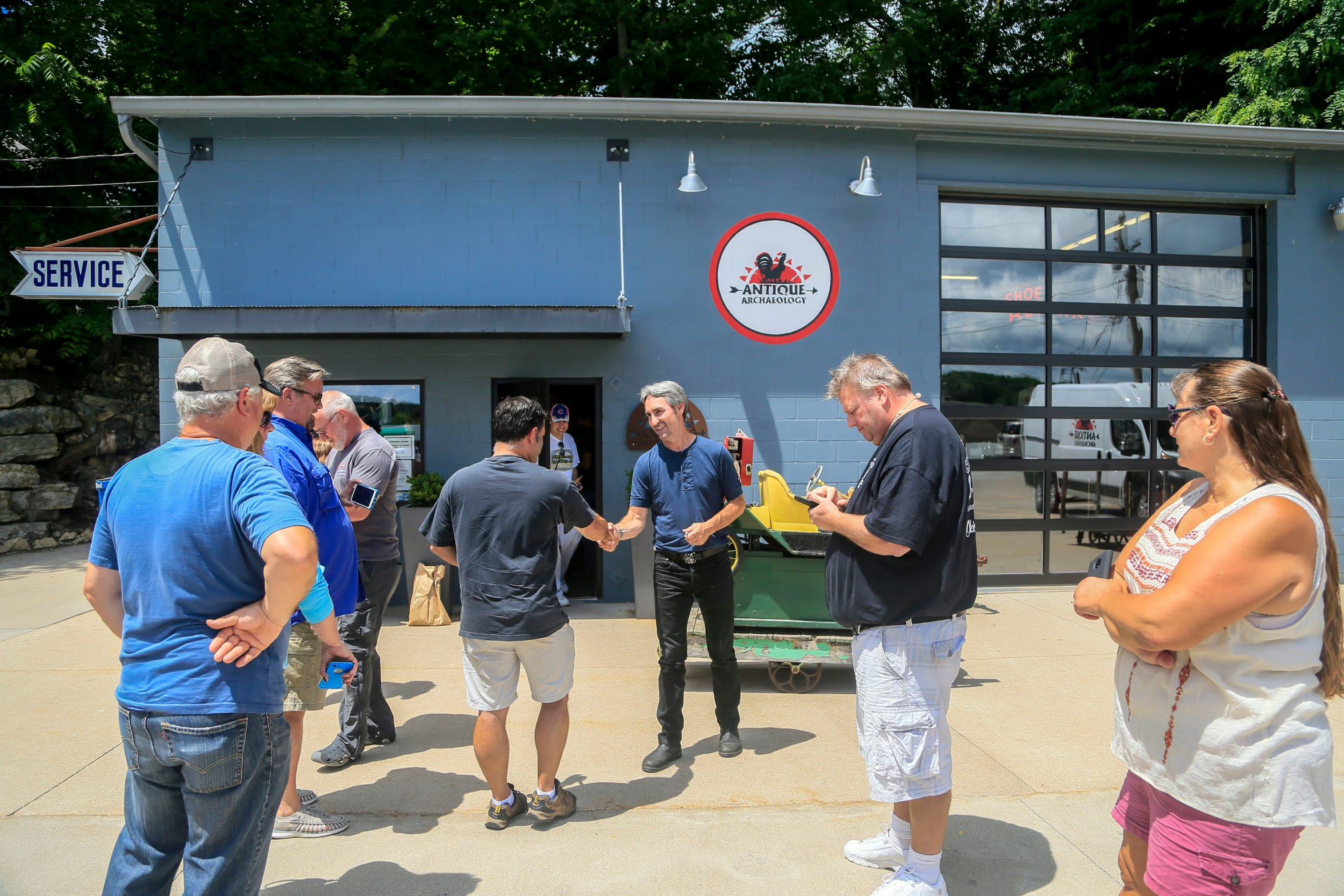 Mike Wolfe of American Pickers fame greets fans outside his store Antique Archaeology in LeClaire June 27, 2018.