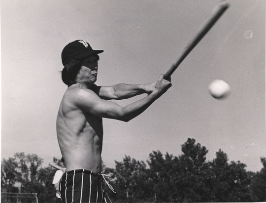 Archived photo: Seiji Ozawa, of the New York Philharmonic, plays a game of pick-up baseball during the orchestra's 1969 visit to Ames, Iowa.